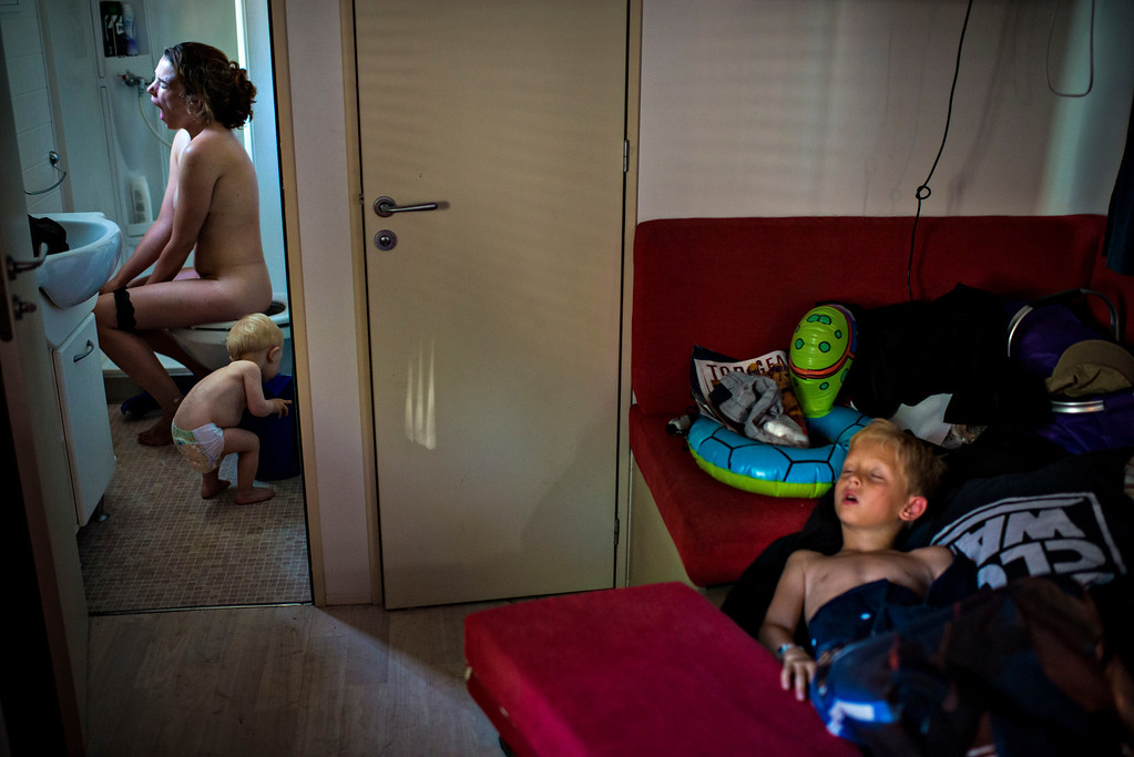 . World Press Photo 2nd prize Daily Life Single by Soren Bidstrup, Denmark, for Berlingske, shows summer holiday camping. Someone is up a little too early in Jeselo, Italy, July 8, 2012. (AP Photo/Soren Bidstrup, Berlingske)