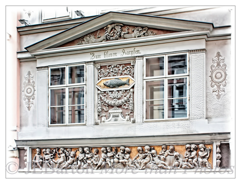 At the sign of the blue Carp A house decoration with partying cherubs and a carp on the house at Annagasse 14, in Vienna's first district.  The houses are from the 17th century - this facade is from 1814.  From the inscription, it probably was a tavern at some point.
