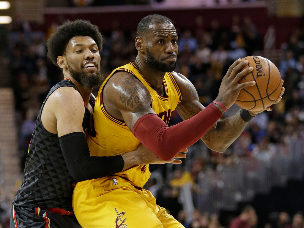 . Atlanta Hawks\' DeAndre Bembry (95) puts pressure on Cleveland Cavaliers\' LeBron James (23) in the second half of an NBA basketball game, Friday, April 7, 2017, in Cleveland. (AP Photo/Tony Dejak)