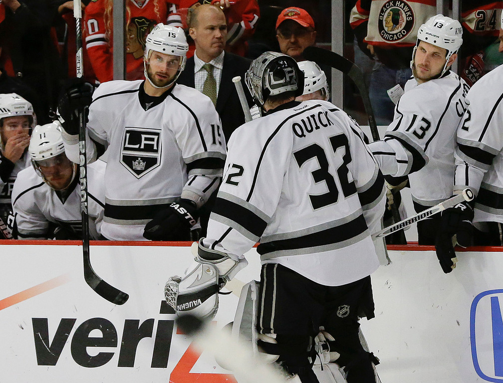 . Los Angeles Kings goalie Jonathan Quick (32) leaves the ice during the second period of Game 2 against the Chicago Blackhawks in the NHL hockey Stanley Cup Western Conference finals, Sunday, June 2, 2013, in Chicago. Quick was replaced by Jonathan Bernier after giving up a fourth goal to the Blackhawks. Chicago won 4-2. (AP Photo/Nam Y. Huh)