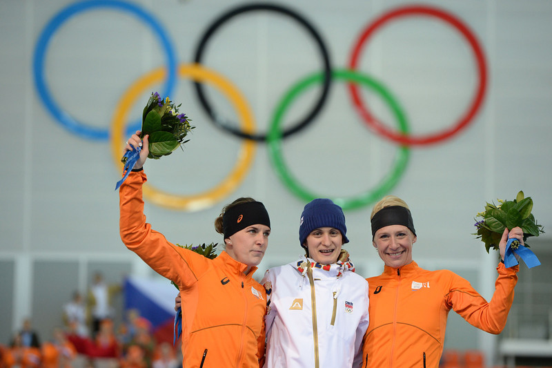 . (From L) Netherlands\' silver medalist Irene Wust, Czech Republic\'s gold medalist Martina Sablikova and Netherlands\' bronze medalist Carien Kleibeuker celebrate during the Women\'s Speed Skating 5000 m Flower Ceremony at the Adler Arena during the Sochi Winter Olympics on February 19, 2014.  (JUNG YEON-JE/AFP/Getty Images)