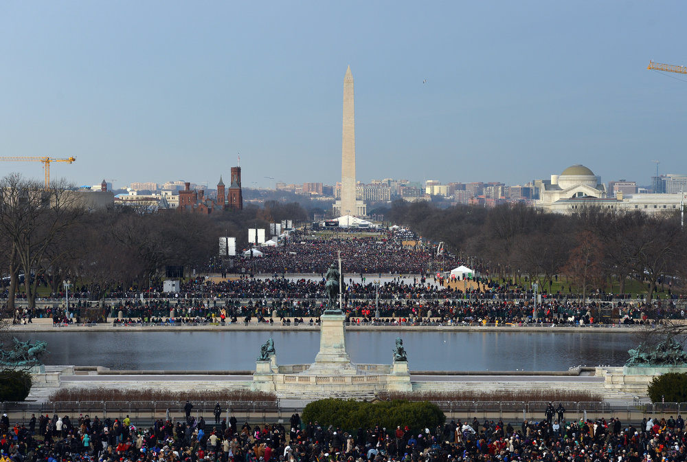 Description of . People crowd the National Mall ahead of US President Barack Obama's 57th Presidential Inauguration ceremonial swearing-in at the US Capitol on January 21, 2013 in Washington, DC. The oath  will be administered by US Supreme Court Chief Justice John Roberts, Jr.  JEWEL SAMAD/AFP/Getty Images