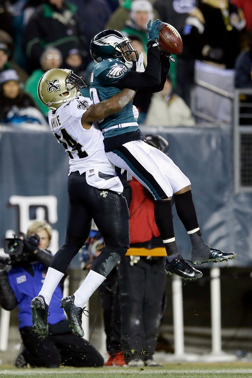 . Philadelphia Eagles\' DeSean Jackson pulls in a pass against New Orleans Saints\' Corey White during the second half of an NFL wild-card playoff football game, Saturday, Jan. 4, 2014, in Philadelphia. (AP Photo/Michael Perez)