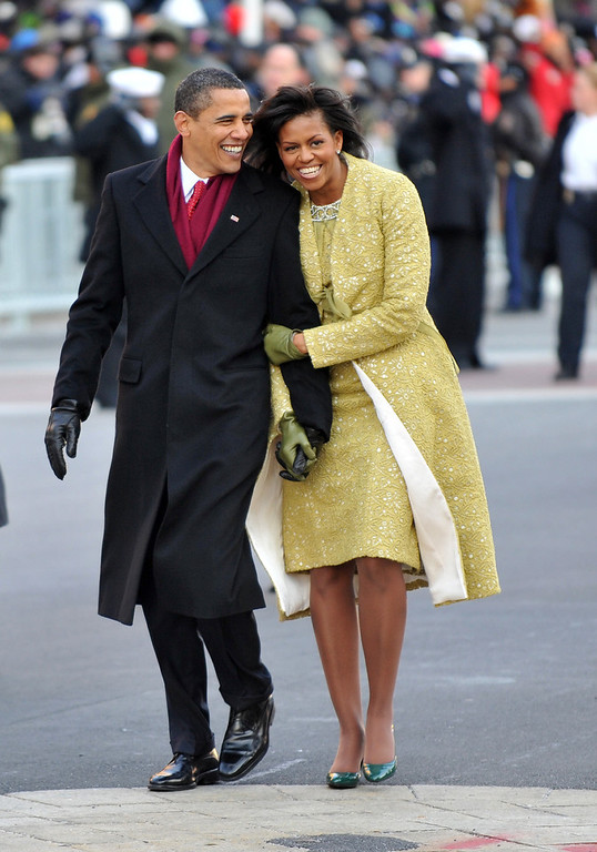 . President Barack Obama and first lady Michelle Obama walk in the Inaugural Parade on January 20, 2009 in Washington, DC. Obama was sworn in as the 44th President of the United States, becoming the first African-American to be elected President of the US.  (Photo by Ron Sachs-Pool/Getty Images)