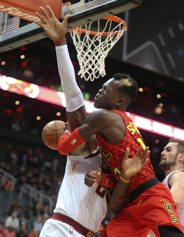 . Atlanta Hawks guard Dennis Schroder (17) passes around Cleveland Cavaliers forward LeBron James (23) in the first half of an NBA basketball game Thursday, Nov. 30, 2017, in Atlanta. (AP Photo/John Bazemore)