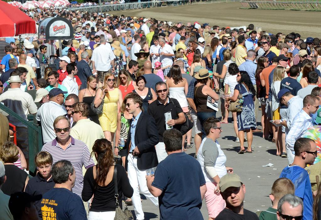 . Prople crowd Saratoga Race Course Saturday on Travers day. Photo Ed Burke/SARATOGIAN 8/24/13