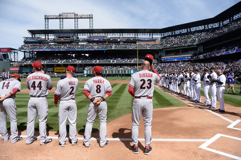 . Arizona Diamondbacks players stand for the National Anthem during the opening ceremonies. The Colorado Rockies hosted the Arizona Diamondbacks in the Rockies season home opener at Coors Field in Denver, Colorado Friday, April 4, 2014. (Photo by Karl Gehring/The Denver Post)