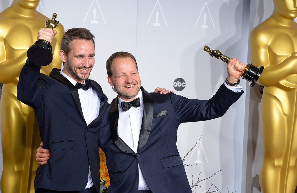 ". Anders Walter and Kim Magnusson accept the Oscar for "" Best Live Action Short Film\"" for the movie Helium, backstage at the 86th Academy Awards at the Dolby Theatre in Hollywood, California on Sunday March 2, 2014 (Photo by David Crane / Los Angeles Daily News)"