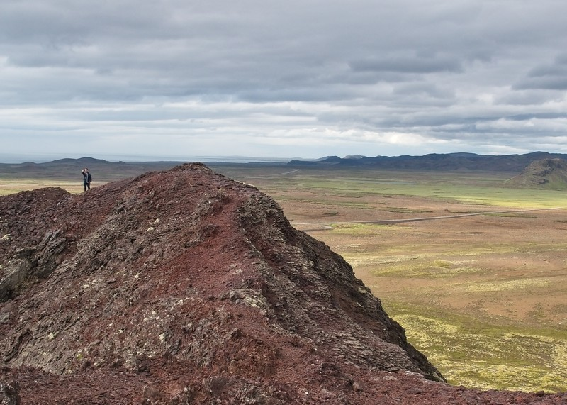 On the rim of the crater with a breathe taking backdrop.