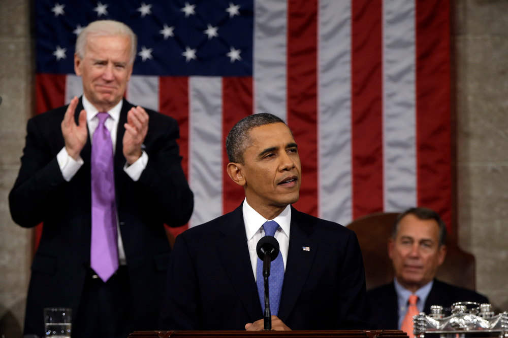 Description of . Vice President Joe Biden applauds as President Barack Obama gives his State of the Union address during a joint session of Congress on Capitol Hill in Washington, Tuesday Feb. 12, 2013. House Speaker John Boehner of Ohio sits at right. (AP Photo/Charles Dharapak, Pool)