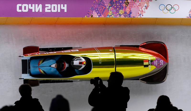 . The team from Belgium BEL-1, piloted by Elfje Willemsen with brakeman Hanna Emilie Marien, take a curve during the women\'s bobsled competition at the 2014 Winter Olympics, Wednesday, Feb. 19, 2014, in Krasnaya Polyana, Russia. (AP Photo/Dita Alangkara)