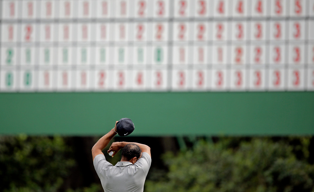 . Tiger Woods wipes his forehead on the 11th green during the first round of the Masters golf tournament Thursday, April 11, 2013, in Augusta, Ga. (AP Photo/Matt Slocum)