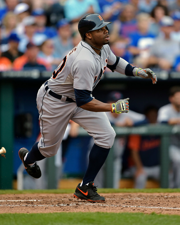. Detroit Tigers left fielder Rajai Davis (20) watches his RBI single, which would give the Tigers a 2-1 lead over the Kansas City Royals, during the seventh inning of a baseball game Saturday, Sept. 20, 2014, in Kansas City, Mo. (AP Photo/Reed Hoffmann)