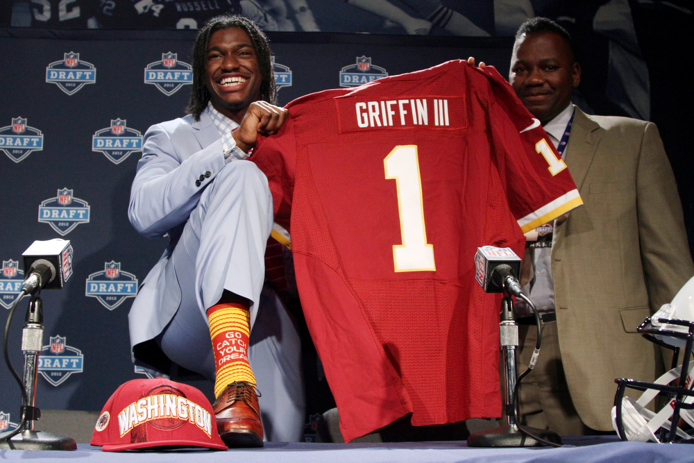 . Robert Griffin III, Baylor Selected second overall by the Redskins in 2012 The AP Offensive Rookie of the Year in 2012, Griffin III passed for 3,200 yards, rushed for 815 yards and led the Redskins to an NFC East title and playoff berth. Griffin�s season ended on a low note when he tore his ACL in the NFC playoffs against fellow rookie quarterback Russell Wilson and the Seahawks.  GRADE: A-. Has the skills of a franchise quarterback, but will his playing style shorten his NFL career? (AP Photo/Mary Altaffer)
