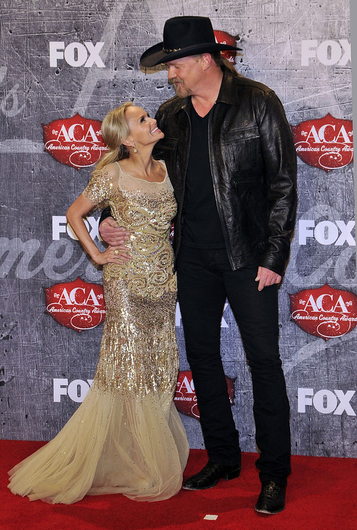 . From left, singer/actress Kristin Chenoweth poses with recording artist Trace Adkins in the press room backstage at the American Country Awards on Monday, Dec. 10, 2012, in Las Vegas. (Photo by Jeff Bottari/Invision/AP)