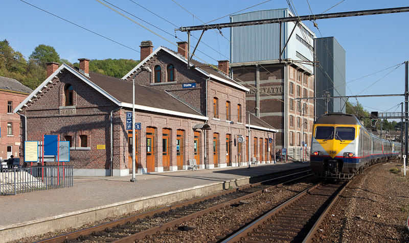 """AM80 346 poses next to the station building and the """"Moulins de Statte""""."""