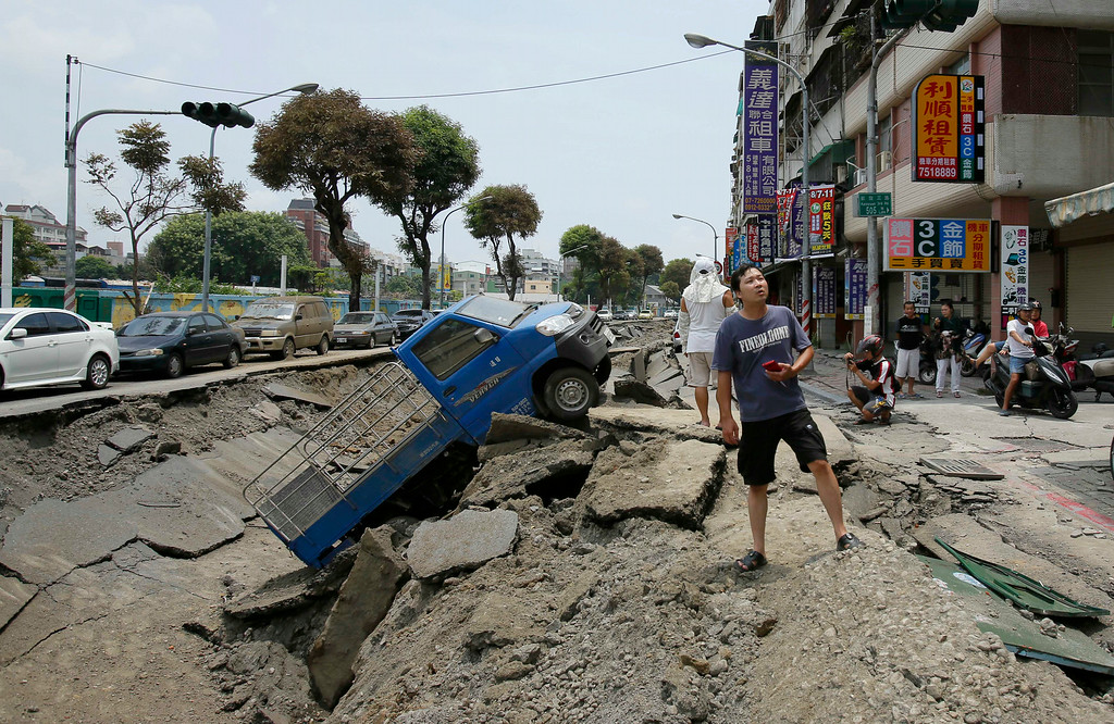 . A toppled truck lies in the rubble after a massive gas explosion in Kaohsiung, Taiwan, Friday, Aug. 1, 2014. A series of explosions about midnight Thursday and early Friday ripped through Taiwan\'s second-largest city, killing scores of people, Taiwan\'s National Fire Agency said Friday. (AP Photos/Wally Santana)