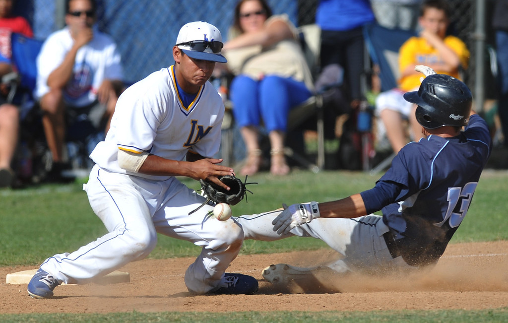 . La Mirada third baseman Ethan Lopez (#8) bobbles the ball as Los Osos\' Ryan Day (#13) slides safely into third base in their CIF quarterfinal baseball game at La Mirada High School on Friday May 24, 2013. Los Osos beat La Mirada 8-5. (SGVN/Staff Photo by Keith Durflinger)