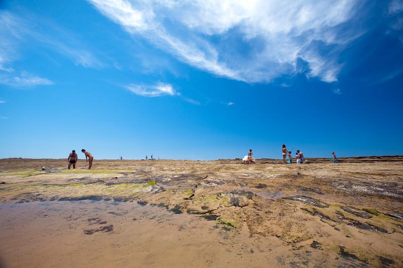 People catching crabs at low tide, Monte Clerigo beach, town of Aljezur, district of Faro, region of Algarve, southwestern Portugal