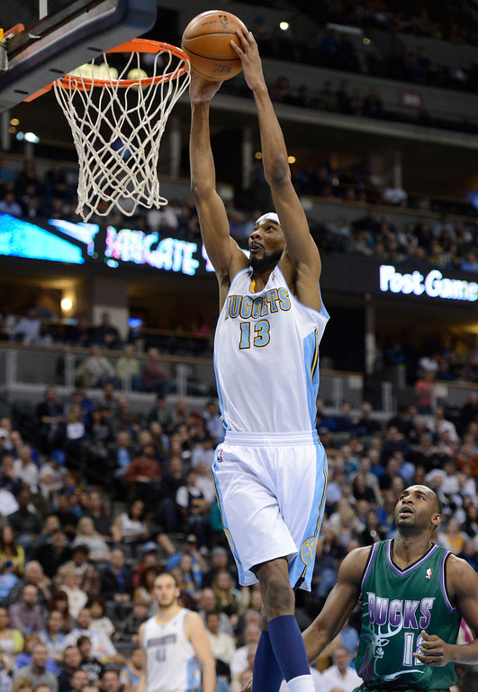 . DENVER, CO. - FEBRUARY 05: Corey Brewer (13) of the Denver Nuggetsj goes up for a dunk past Luc Richard Mbah a Moute (12) of the Milwaukee Bucks during the second quarter February 05, 2013 at Pepsi Center. The Denver Nuggets take on the Milwaukee Bucks in NBA action. (Photo By John Leyba/The Denver Post)