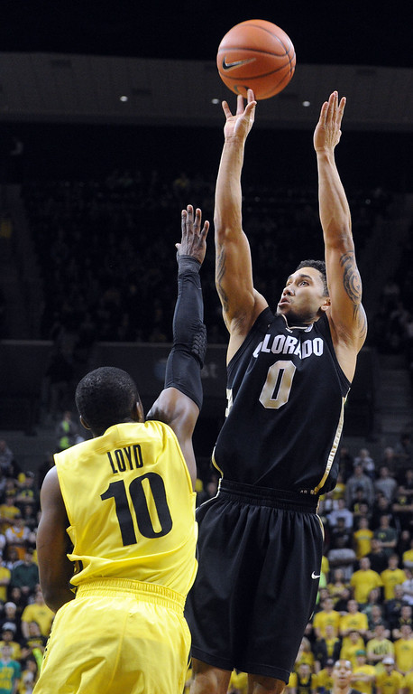 . Askia Booker #0 of the Colorado Buffaloes shoots the ball over Johnathan Loyd #10 of the Oregon Ducks in the first half of the game  at Matthew Knight Arena on February 7, 2013 in Eugene, Oregon. (Photo by Steve Dykes/Getty Images)