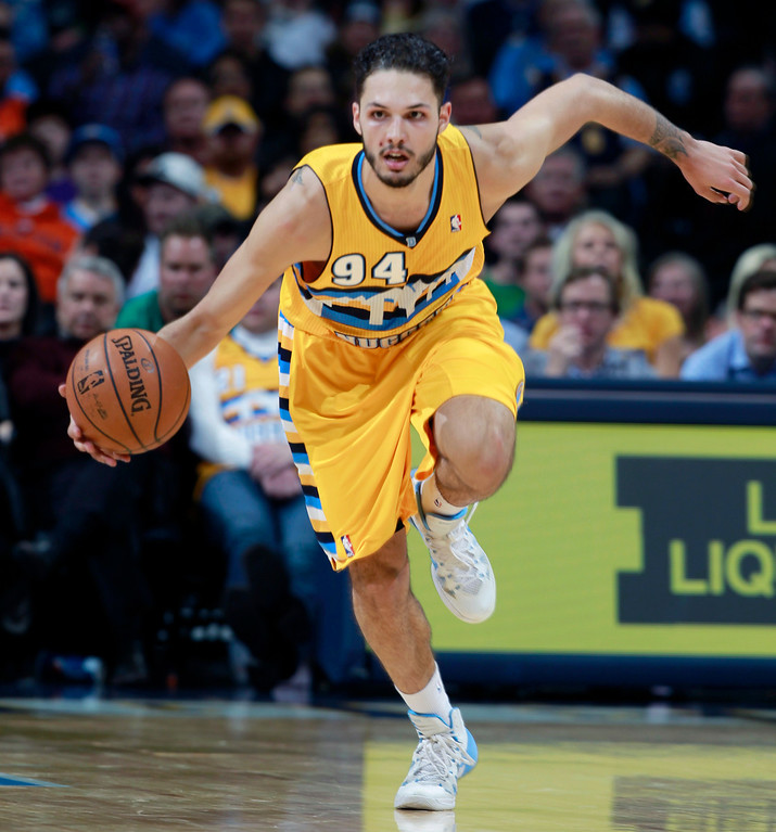 . Denver Nuggets guard Evan Fournier, of France, picks up loose ball and heads down the court against the Toronto Raptors in the fourth quarter of the Raptors\' 100-90 victory in an NBA basketball game in Denver on Friday, Jan. 31, 2014. (AP Photo/David Zalubowski)
