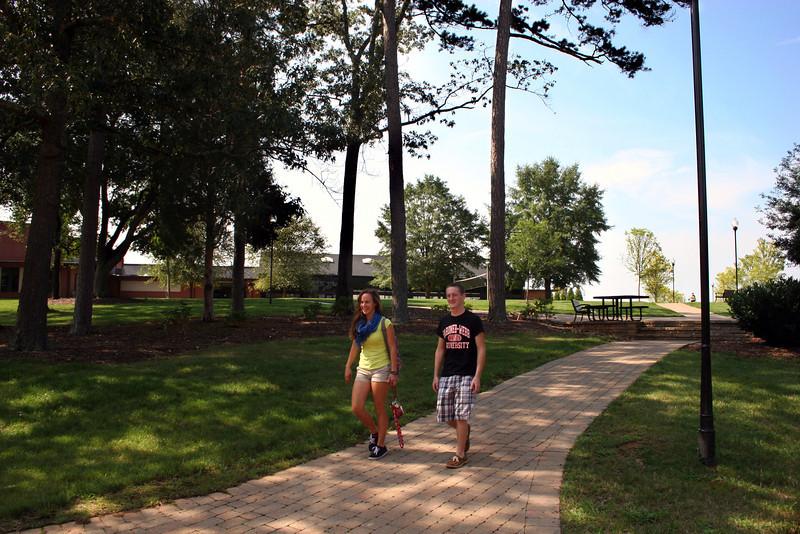 Two Gardner-Webb students walking across campus.