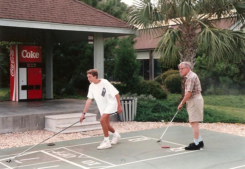 Edward and his Granddaddy playing shuffleboard - Kure Beach 8/92