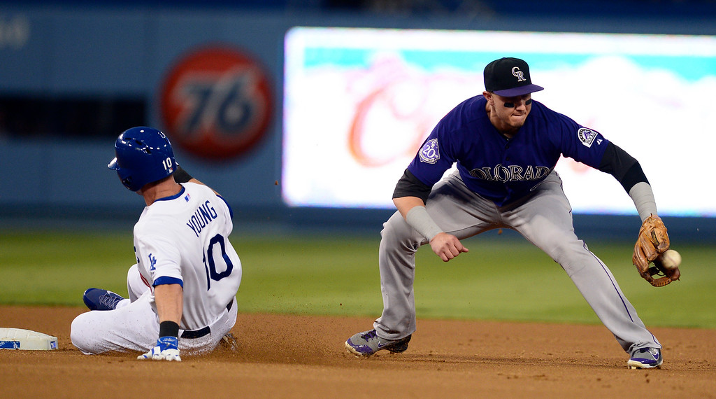. Rockies\' Troy Tulowitzki #2 attempts to out Dodgers\' Michael Young #10 at second during a double base hit in the second inning at Dodger Stadium Saturday, September 28, 2013. (Photo by Sarah Reingewirtz/Pasadena Star-News)