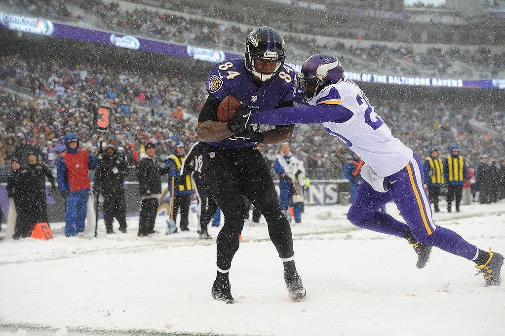 . Tight end Ed Dickson #84 of the Baltimore Ravens beats cornerback Chris Cook #20 of the Minnesota Vikings for the game\'s first touchdown at M&T Bank Stadium on December 8, 2013 in Baltimore, Maryland. (Photo by Larry French/Getty Images)