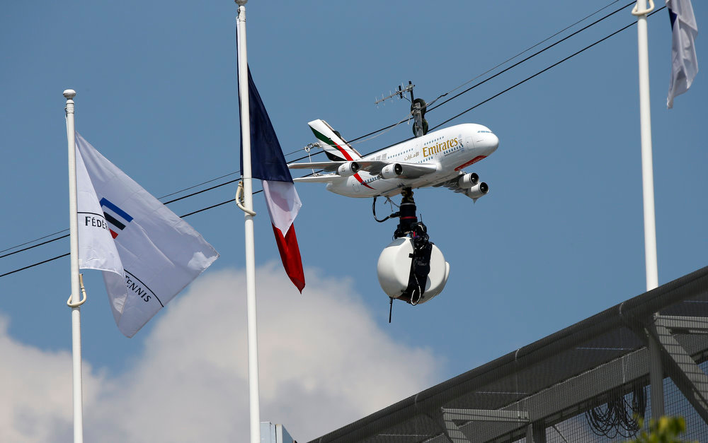. A plane model bearing the colors of Emirates airlines holds a camera above the Roland Garros stadium on the second day of the French Tennis Open tournament in Paris, on May 27, 2013.   THOMAS COEX/AFP/Getty Images