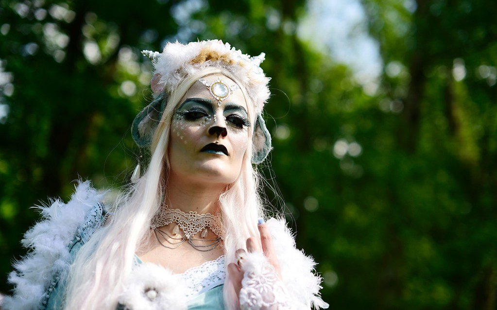 ". A dressed up woman poses at a so-called ""Victorian Picnic\"" during the Wave-Gotik-Treffen (WGT) festival in Leipzig, eastern Germany, on May 13, 2016.   / AFP PHOTO / TOBIAS SCHWARZ/AFP/Getty Images"