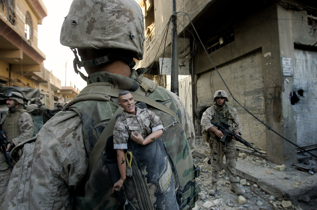 . In Sunday, Nov. 14, 2004 file photo, a U.S. Marine of the 1st Division carries a mascot for good luck in his backpack as his unit pushed further into the western part of Fallujah, Iraq, Sunday, Nov. 14, 2004. Anja (AP Photo/Anja Niedringhaus, File)