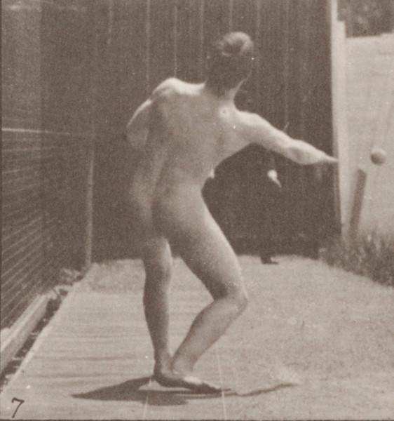 Nude man playing baseball, pitching