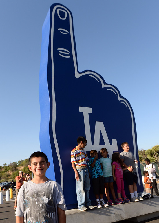 . William smiles as he poses for a picture in front the giant foam finger as members of the San Fernando Valley Rescue Mission are treated to a Major league baseball game between the Miami Marlins and the Los Angeles Dodgers on Wednesday, May 14, 2014 in Los Angeles. The Mission experienced a devastating fire earlier this month. Damage sustained included the destruction of the San Fernando Valley Rescue Mission�s emergency shelter, vehicle fleet, clothing warehouse and food pantry which were vital in aiding those of need in the San Fernando Valley.  (Keith Birmingham/Pasadena Star-News)
