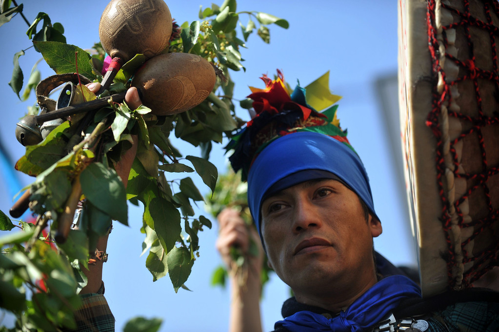 . A Mapuche indigenous man marches during a protest for the commemoration of Columbus Day in downtown Santiago, on October 12, 2013. HECTOR RETAMAL/AFP/Getty Images