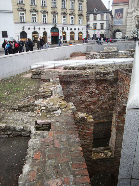 There are a series of older foundations beneath the modern city, starting with early 20th century, and dating back to roman times. This was in front of the Imperial Palace.