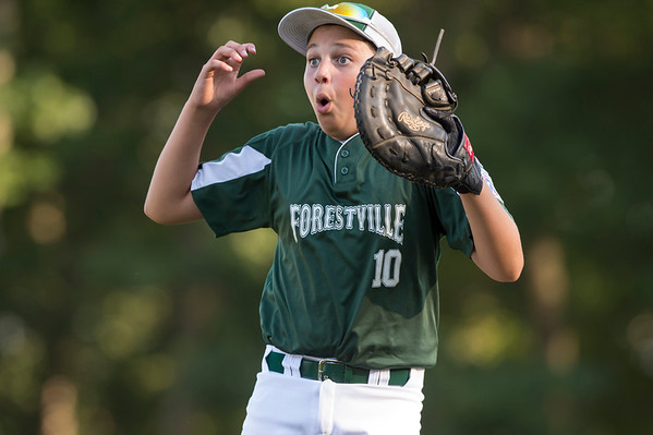 07/08/19 Wesley Bunnell | Staff Forrestville vs Southington North Little League baseball at Recreation Park in Southington on Monday July 8, 2019. Greyson Pierce (10) reacts after the runner was ruled safe at first.