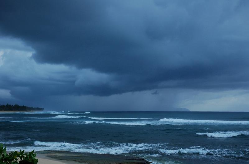 Blue-grey clouds at sunsetat Sunset Beach on the    North Shore of O'ahu, Hawai'i