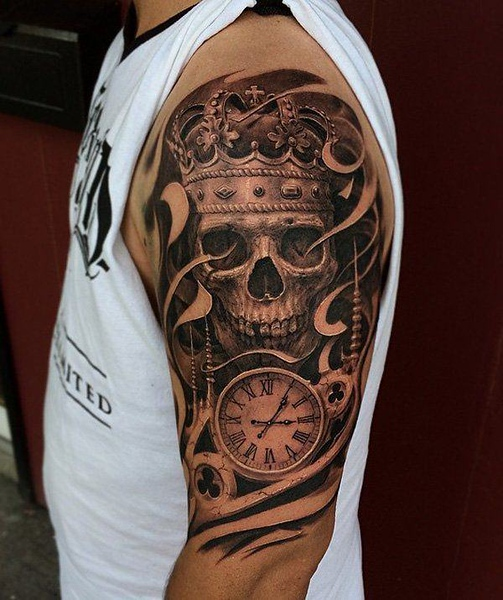 Grey-shaded-skull-and-crown-with-clock-tattoo-on-upper-sleeve-for-men.jpg