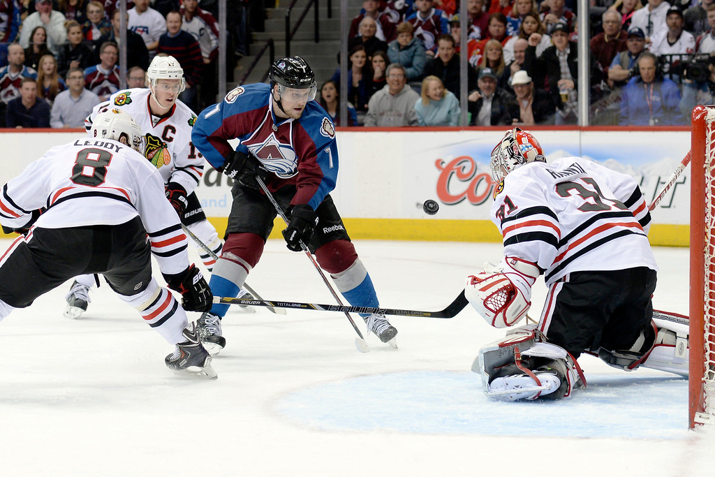 . Colorado center John Mitchell (7) put a shot on net in the third period.   (Photo by Karl Gehring/The Denver Post)