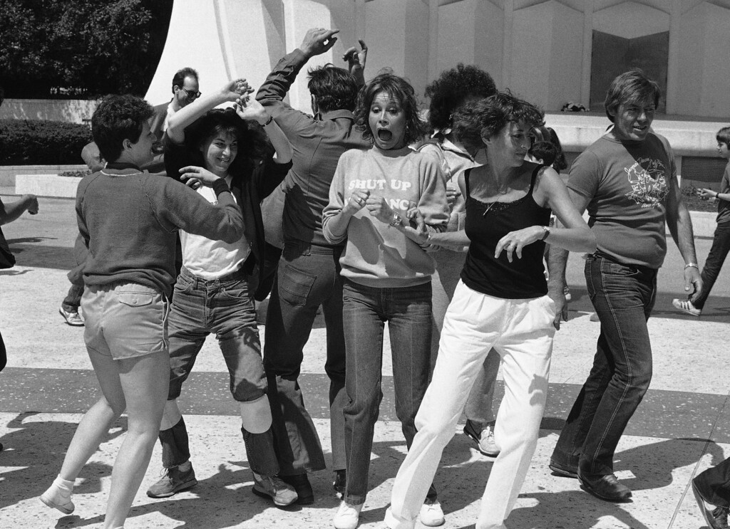 . Actress Mary Tyler Moore, center, dances with a group of New York City policemen and school children, in New York, May 14, 1983. The group was rehearsing for the National Dance Institute�s upcoming �Event of the Year,� which opens at New York�s Felt Forum on May 23. (AP Photo/Mario Suriani)