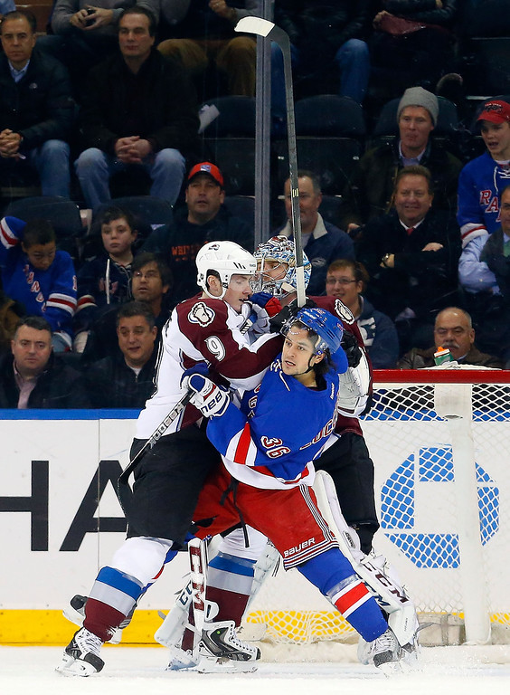 . Mats Zuccarello #36 of the New York Rangers battles for position in front of the net during the first period against Matt Duchene #9 of the Colorado Avalanche at Madison Square Garden on February 4, 2014 in New York City.  (Photo by Jim McIsaac/Getty Images)