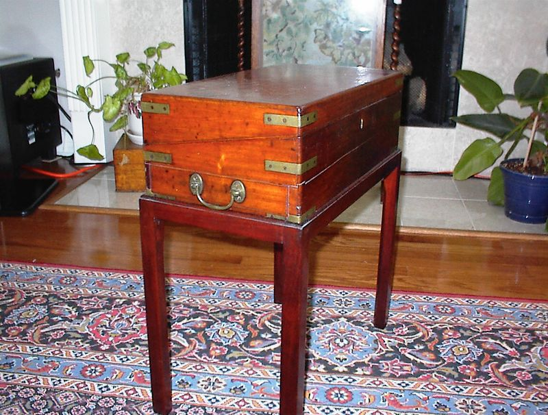 Family room - 19th century mahogany campaign style lap desk on stand (not original to the piece), shown in the closed position. Used as an end table.