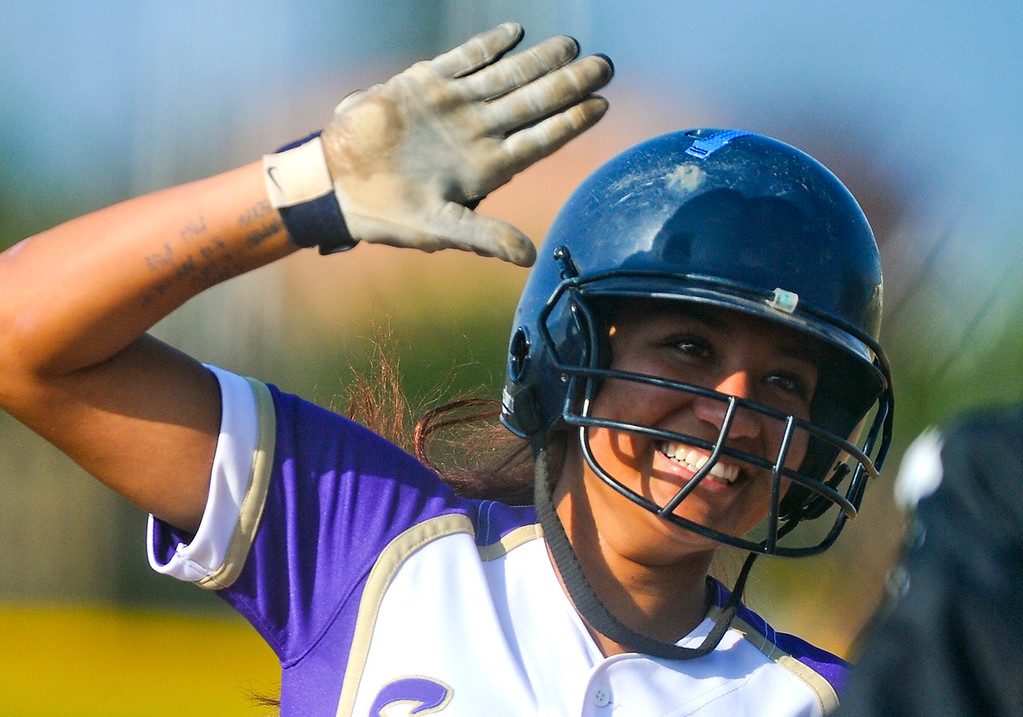 . Jackie Valadez (8) high-fives her coach as she rounds third base after hitting a two-run walk-off homerun in the bottom of the seventh inning against Citrus Valley High School on Tuesday, May 7, 2013. Jurupa Hill defeated Citrus Valley 2-3. (Rachel Luna / Staff Photographer)