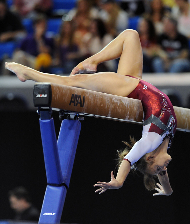 . Alabama\'s Kim Jacob performs on the balance beam at the NCAA Women\'s Gymnastics Championship Team Finals at Pauley Pavilion, Saturday, April 20, 2013. (Michael Owen Baker/Staff Photographer)