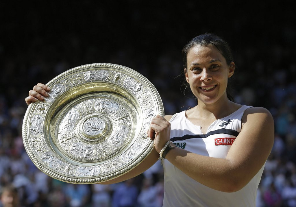 ". <p>4. MARION BARTOLI  <p>Wimbledon champ retires because of excruciating pain, mostly from reading Twitter. (unranked) <p><b><a href=\'http://www.dailymail.co.uk/news/article-2357553/French-tennis-star-won-Wimbledon-faces-Twitter-backlash-vile-online-trolls-calling-fat-ugly-win.html\' target=""_blank\""> HUH?</a></b> <p>   (AP Photo/Anja Niedringhaus, File)"