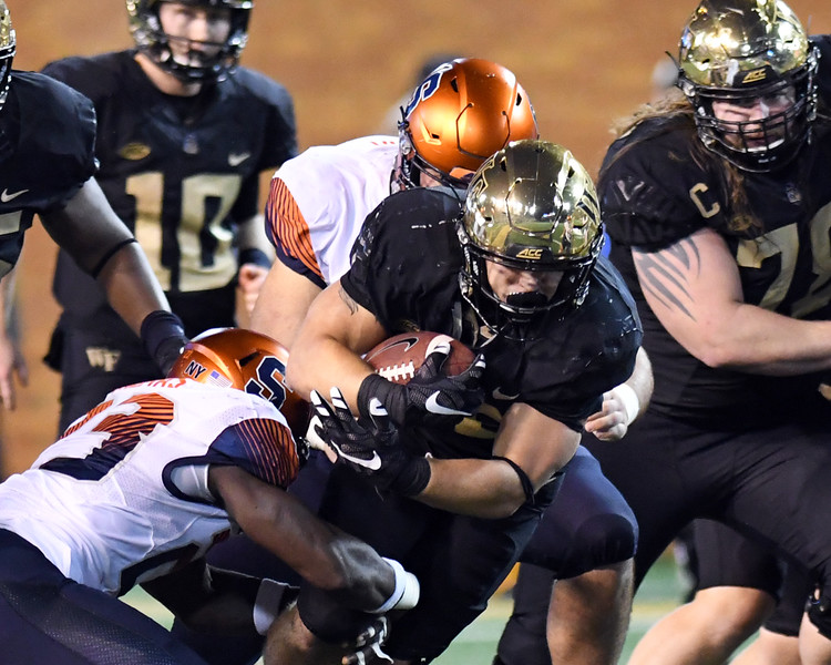Cade Carney fights for yards 02.jpg
