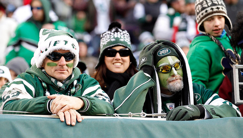 . Dejected New York Jets fans look on during the fourth quarter of their NFL football game against the San Diego Chargers in East Rutherford, New Jersey December 23, 2012.       REUTERS/Adam Hunger