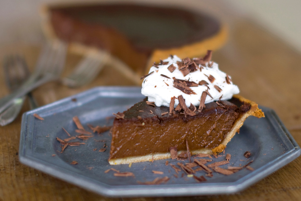 """. <a href=\""""http://www.dallasnews.com/life/recipes/2011/11/22/pumpkin-and-chocolate-team-up-for-memorable-midnight-pie\"""">Get the recipe for midnight pumpkin pie</a>. This pumpkin pie recipe combines chocolate and pumpkin into a perfectly rich treat that honors tradition while satisfying the need for chocolate.   (AP Photo/Matthew Mead)"""